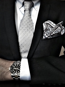 Black. Elevate a basic black suit with the perfect accessorizing