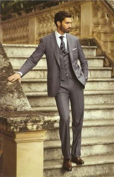 Burberry grey suit being a 3-piece.