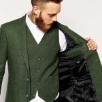Groom in rustic vintage green jacket and waistcoat