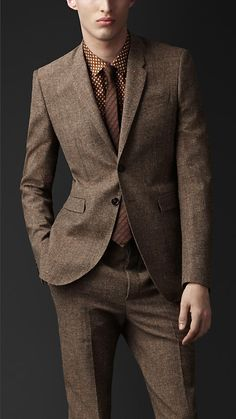 the tailored double buttoned suit with two back vents