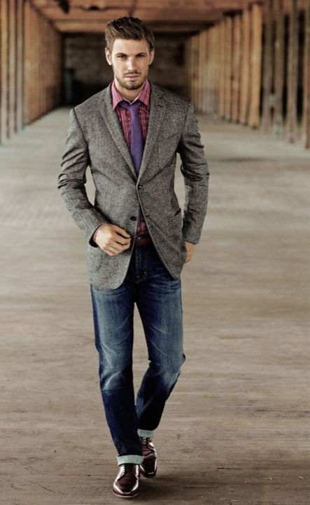 A suit jacket is more structured, spare in details, smooth in fabric, and formal in appearance; thus, paired with the casualness of jeans, the resulting look is simply too discordant and jarring. The blazer jacket sits in-between the formality levels of the suit jacket and the sports jacket.