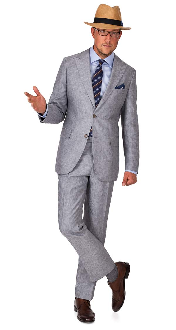 Linen suits are notoriously easy to wear and mix and match. You have the options to go with a muted palette or go bold and bright. One of our favorite looks of the summer season is a dark navy linen suit, a lightweight micro-check button up in light blue and white and boat shoes without socks.